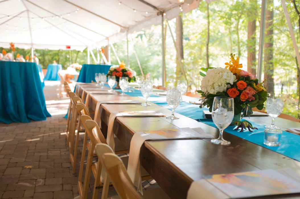 Farm tables under tent for formal event
