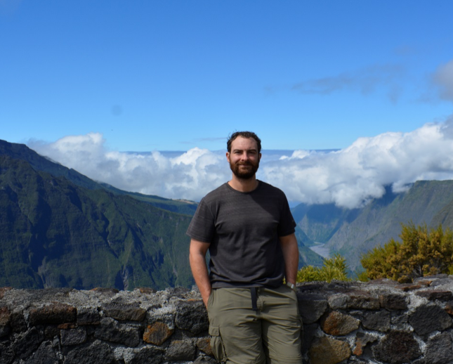 Image of James Hererra, DLC-SAVA Program Coordinator, standing on a mountain in Madagascar