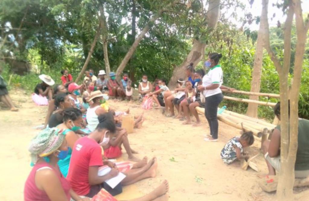 Women gather outside at a DLC-SAVA conservation workshop